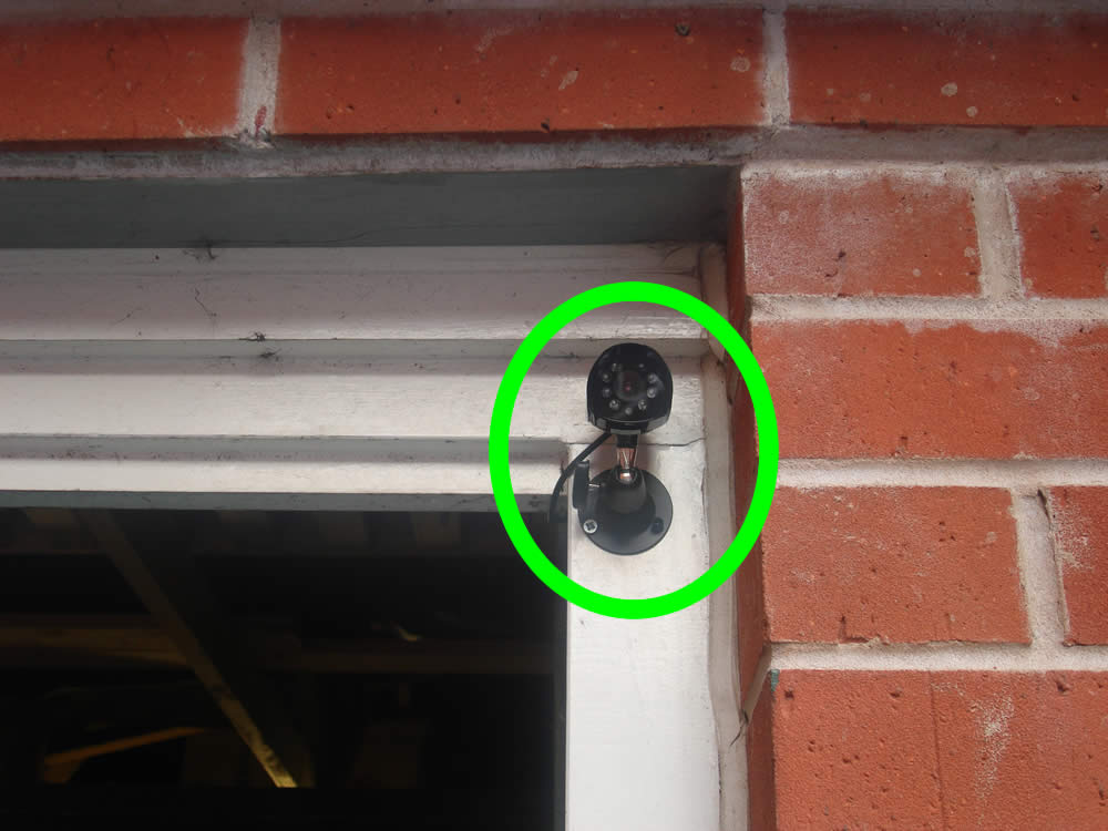 Picture showing CCTV camera mounted on the outside of my garage
