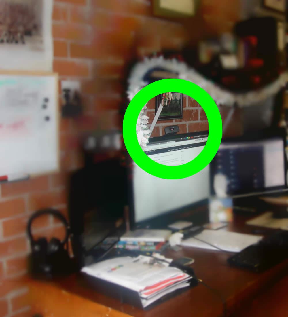 Picture showing webcam angled towards door of garage/office