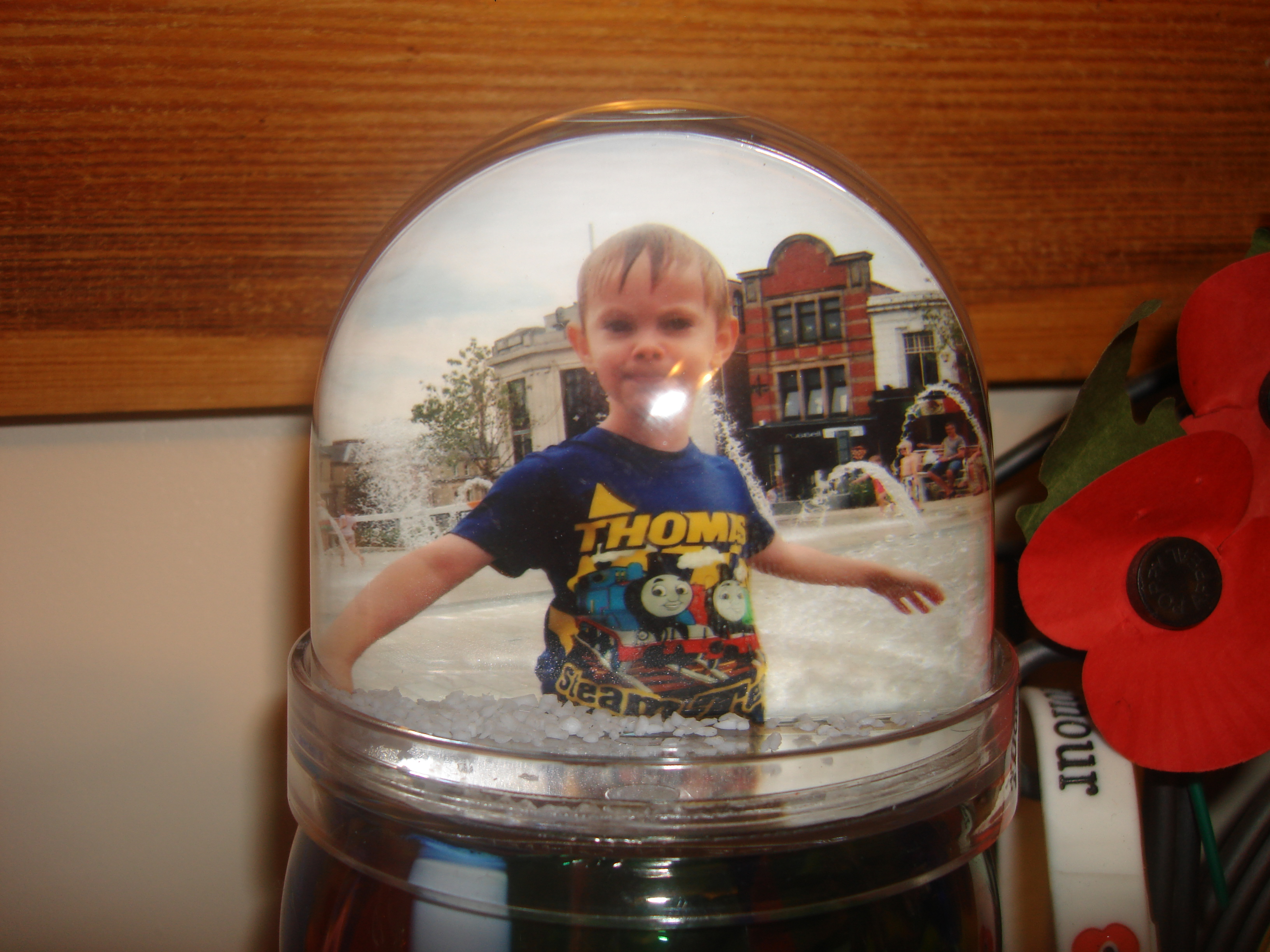 Image of a snow globe with a picture of my son inside it
