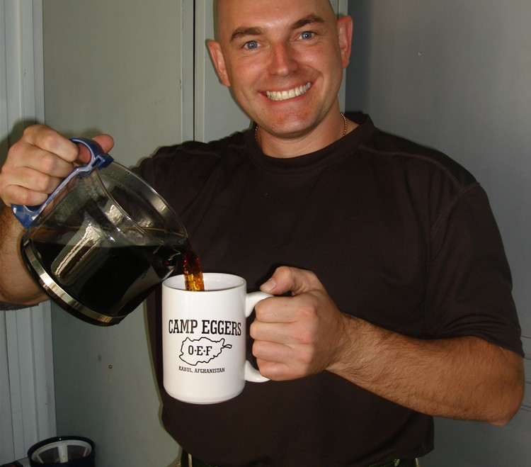 An image of me pouring a cup of coffee whilst on operation tour in Afghanistan