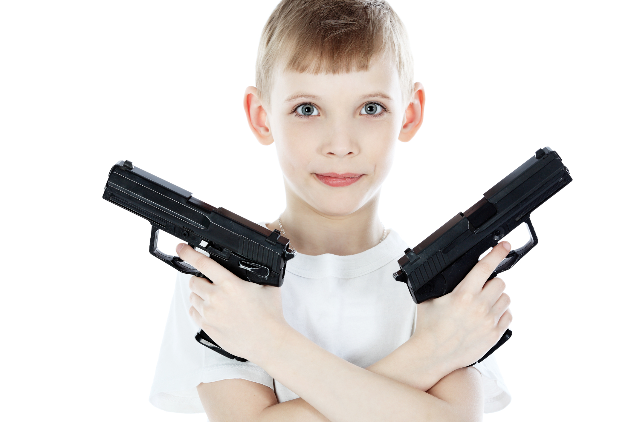 image of a child holding 2 toy guns
