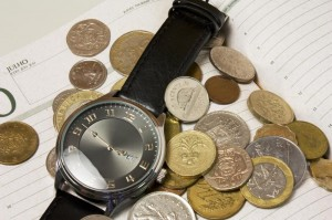 An image of a watch surrounded by money showing that time is money